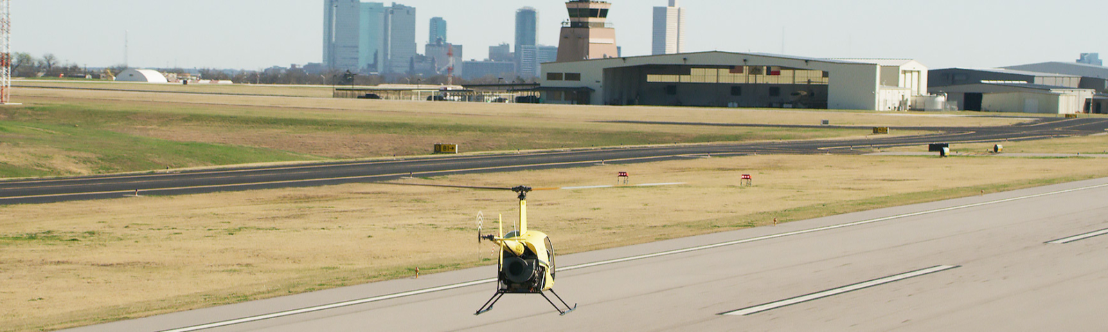 helicopter hovering downtown fort worth in the background
