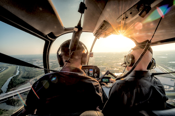 Two Pilots Flying in Helicopter